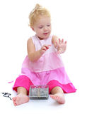 Little girl dressed up sitting on the floor Royalty Free Stock Photography
