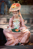 Little girl dressed in Victorian clothes stock photo