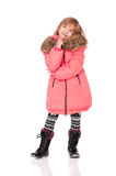 Little girl dressed with winter clothes Royalty Free Stock Photography