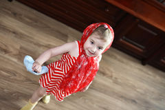 Little girl in dresses dancing with handkerchief Stock Photography