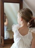 Little girl dresses up. Royalty Free Stock Images
