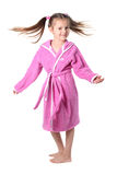Little girl in dressing gown. (in movement Stock Photos