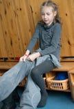 Little girl dressing up in kindergarten. Stock Image