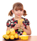 Little girl drink lemonade Stock Photos