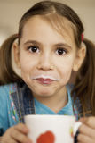Little girl drink milk Royalty Free Stock Photography