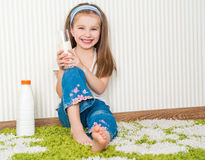 Little girl drink the milk Royalty Free Stock Images
