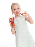 Little girl drink tasty red tomato juice Stock Images
