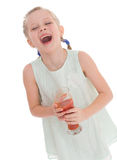 Little girl drink tasty red tomato juice Royalty Free Stock Photography