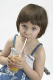 Little girl drinkig juice Royalty Free Stock Images
