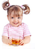 Little girl drinking apple juice Royalty Free Stock Images