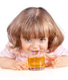 Little girl drinking apple juice Royalty Free Stock Photography