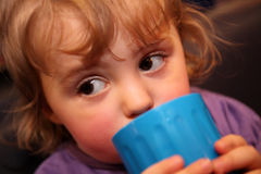 Little girl drinking Royalty Free Stock Images