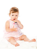 Little girl is drinking from bottle Stock Photo