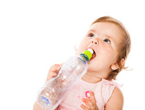 Little girl is drinking from bottle Stock Photo
