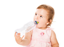Little girl is drinking from bottle Royalty Free Stock Image