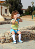 Little girl drinking from bottle. Outdoor photo Royalty Free Stock Photo