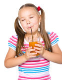 Little girl is drinking carrot juice Royalty Free Stock Images