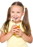Little girl is drinking carrot juice Royalty Free Stock Photos