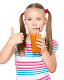 Little girl is drinking carrot juice Royalty Free Stock Photo