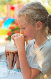 Little girl drinking. Little girl drinking chocolate milk shake Stock Photos