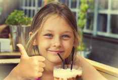 Little girl drinking Royalty Free Stock Photos