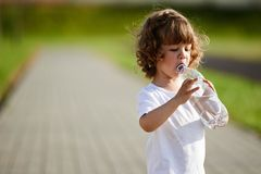 Little girl drinking clean water from bottle Royalty Free Stock Image