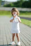 Little girl drinking clean water from plastic Royalty Free Stock Photos