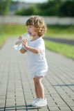 Little girl drinking clean water from plastic Stock Image