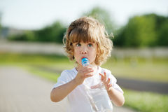 Little girl drinking clean water from plastic Royalty Free Stock Photography