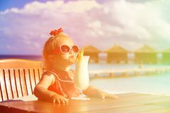 Little girl drinking cocktail on tropical beach Royalty Free Stock Photography
