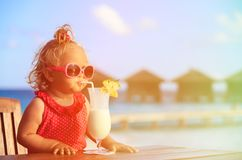Little girl drinking cocktail on tropical beach Royalty Free Stock Photo