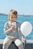 Little girl drinking cocoa Royalty Free Stock Image