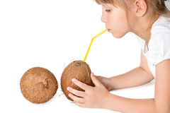 Little girl drinking coconut water Stock Photos