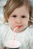 Little girl drinking Stock Image