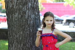 Little girl drinking drink Stock Image