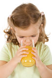 Little girl drinking fruit juice. Isolated Stock Photo