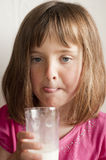 Little girl drinking glass of milk Royalty Free Stock Image