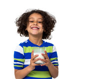 Little girl drinking a glass of milk Stock Image