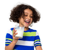 Little girl drinking a glass of milk Royalty Free Stock Photo