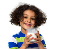 Little girl drinking a glass of milk Royalty Free Stock Photography