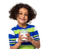 Little girl drinking a glass of milk Stock Photography