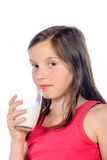 A little  girl is drinking a glass of milk Royalty Free Stock Photo