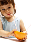 Little girl drinking a grapefruit juice. Little girl drinking a grapefruit Royalty Free Stock Image