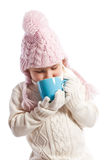 Little girl drinking hot beverage. Royalty Free Stock Photography