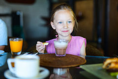 Little girl drinking hot chocolate Royalty Free Stock Photos