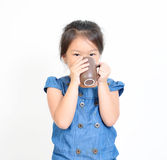 Little girl drinking the hot drink. Stock Images