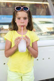 Little girl drinking a iced Royalty Free Stock Images