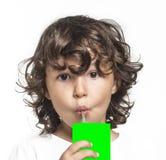 Little girl drinking juce. Little girl drinking green screen juce Royalty Free Stock Photo