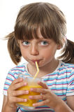 Little girl drinking  juice. Little girl drinking orange juice Royalty Free Stock Photos