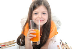 Little girl drinking juice from a glass Stock Images